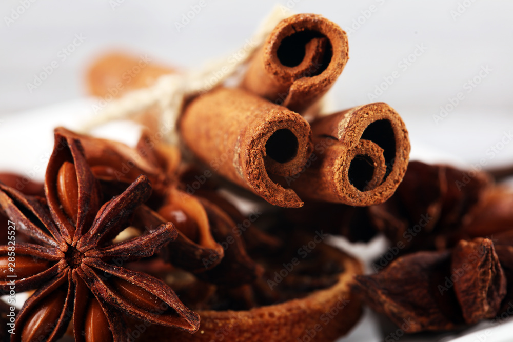 Fototapety, obrazy: cinnamon, staranise and cloves. winter spices on wooden table