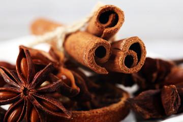 Obraz na płótnie Canvas cinnamon, staranise and cloves. winter spices on wooden table