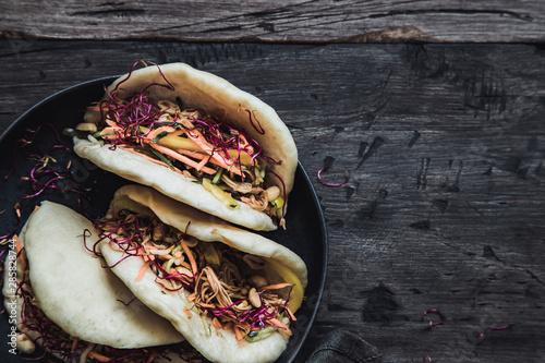 Fototapeta Steamed vegan bao buns with vegetables and peanuts. obraz