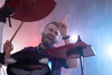 Emotions, Drums, Hobby And People Concept - Rock Musician Playing The Drums On The Stage
