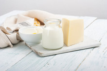 Dairy Products On Old White Wo...