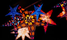 Star As Christmas Tree Decorations In Christmas Market In Germany