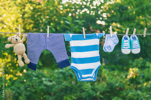 Obraz washing baby clothes. Linen dries in the fresh air. Selective focus. - fototapety do salonu