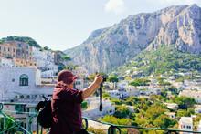 Senior Woman Taking Photo In Capri Island