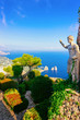 canvas print picture - Statue and green gardens in Capri Island town