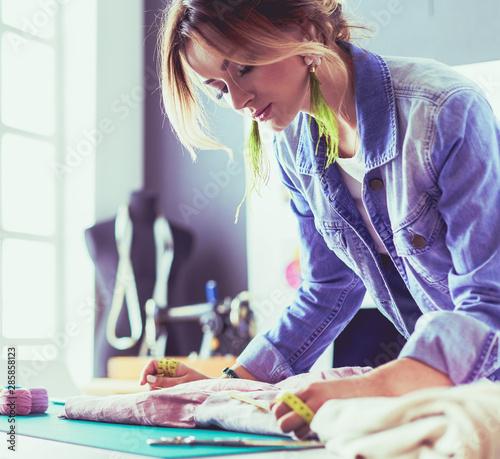 Fotografia, Obraz Fashion designer woman working on her designs in the studio