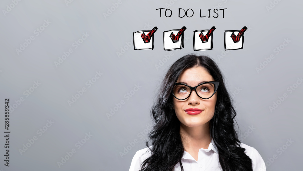 Fototapeta To do list with young businesswoman in a thoughtful face