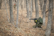 Active Military Exercises In The Forest. Shootout Army In The Autumn Forest. Training Airsoft Teams In Russia.