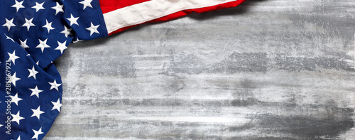 Poster Equestrian US American flag on worn white wooden background. For USA Memorial day, Veteran's day, Labor day, or 4th of July celebration. With blank space for text.
