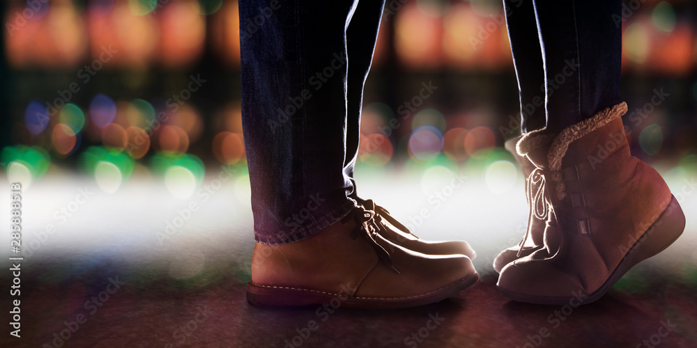 Fototapeta Love and Relationship Concept, Low Section of Couple Kissing in Winter Romantic Night. Side View. Lights Bokeh in City as background