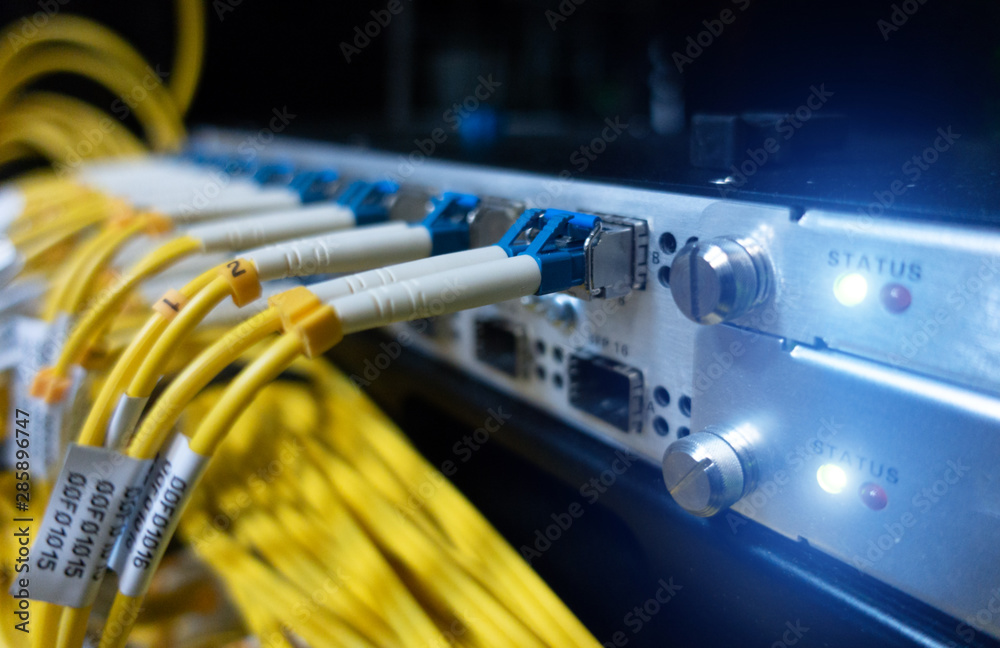 Fototapeta Optic fiber cables connected to data center