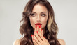 canvas print picture - Beautiful girl  long , curly hair . Model woman showing a red   manicure on nails   . Cosmetics and makeup