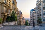 Fototapeta Fototapety Paryż - Montmartre district of Paris. Morning Montmartre staircase in Paris, France. Europa. View of cozy street in quarter Montmartre in Paris, France. Architecture and landmarks of Paris. Postcard of Paris.