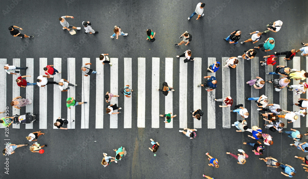Fototapeta Aerial. People crowd motion on pedestrian crosswalk. Top view from drone.