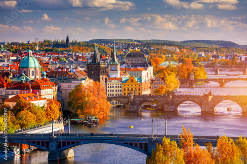 Autumn view to Charles bridge on Vltava river in Prague, Czech Republic Wallpaper Mural