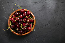 Ripe Cherries In A Wooden Bowl...