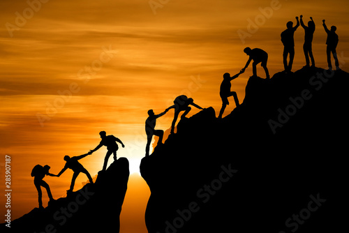 Group of people on peak mountain climbing helping team work , travel trekking su Fototapet