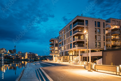 Oslo, Norway. Night View Embankment And Residential Multi-storey House On Sorengkaia Street In Gamle Oslo District. Residential Area In Summer Evening