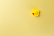 Yellow Rubber Duck On Yellow Background. Minimal Style With Colorful Paper Backdrop. Top View. Trendy Colorful Photo. Flat Lay. Copy Space. Minimal Creative Concept