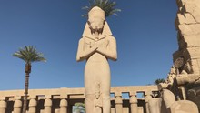 Ramses II Enormous Stone Statue In Peristyle Courtyard In The Temple Of Amun-Ra At Karnak Antique Thebes Luxor, Egypt.