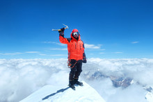 Happy Man Climber In Bright Red Down Jacket Reaches The Summit Of Mount Everest, Nepal.