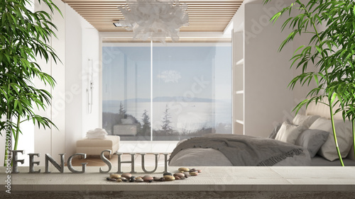 Fotografija  Wooden vintage table shelf with pebble and 3d letters making the word feng shui