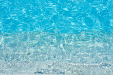 Background Of Water In Blue Swimming Pool, Water Surface With A Sun Reflection