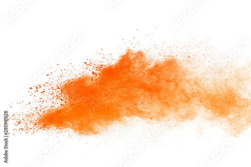 Abstract orange powder explosion. Closeup of orange dust particle splash isolated on white background - fototapety na wymiar