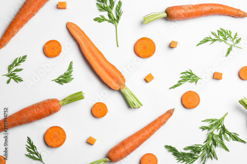 Tasty ripe carrots and leaves isolated on white, top view Fototapeta