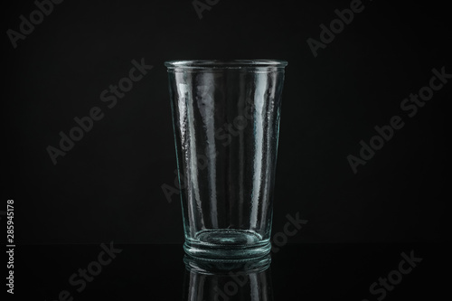 Fototapeta Elegant empty colorful glass on black background obraz na płótnie