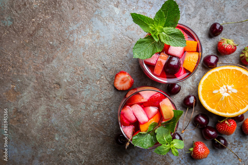 Valokuvatapetti Red wine sangria or punch with fruits and ice in glasses top view