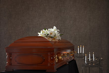 Wooden Casket With White Lilie...