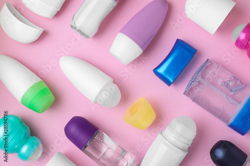 Flat lay composition with different natural deodorants on pink background Wallpaper Mural