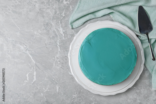 Delicious homemade spirulina cheesecake served on marble background, top view. Space for text