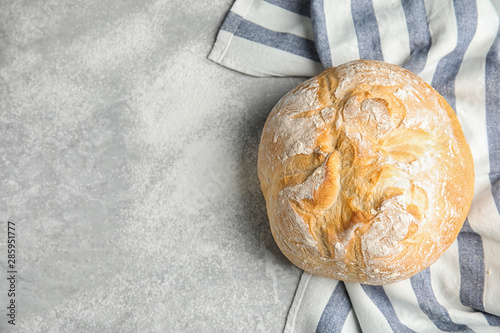 Loaf of fresh bread on grey marble background, top view Canvas Print
