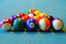 Playing Billiard Pool Game With Colorful Balls