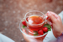 Fruit Red Tea With Wild Berries In Glass Cup, In Forest, On Bright Background.