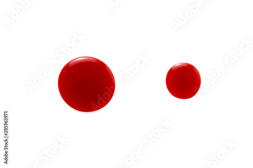 Fotomural Red color lip gloss drop on background