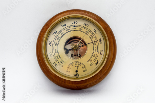 Aneroid barometer in a wooden case on a white background. Canvas Print