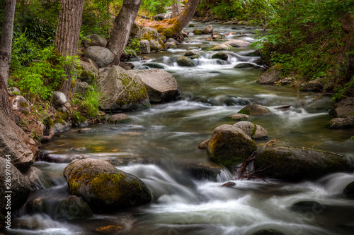 Canvas Print Long exposure of water flowing over rocks at Lithia Park in Ashland Oregon
