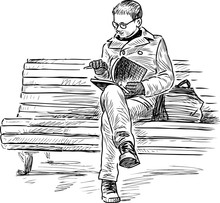 Young Townsman Sits On Park Bench And Reads A Book