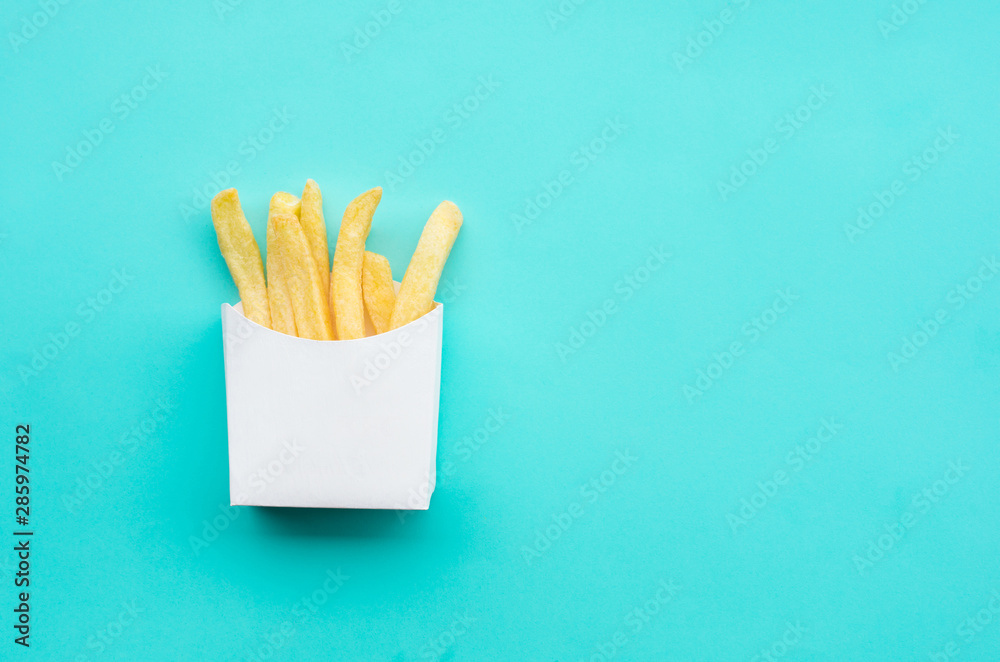 Fototapety, obrazy: Top view of close up french fried in white box container on blue table background