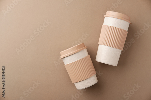 Fototapeta  Two Eco Coffee Cup Isolated on Beige Background