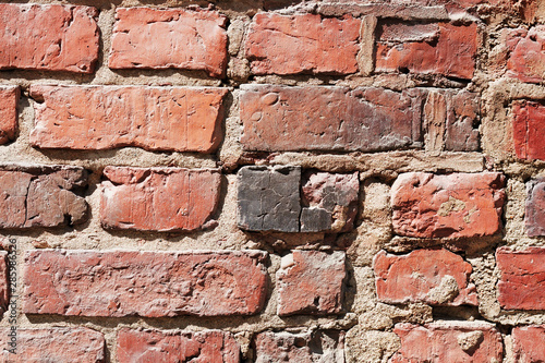 Fragment of rough brick wall #285986526