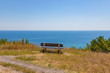 Empty bench on the hill. Seascape on the background. Greece travel concept.