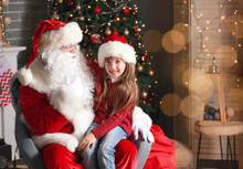 Santa Claus And Little Girl In...