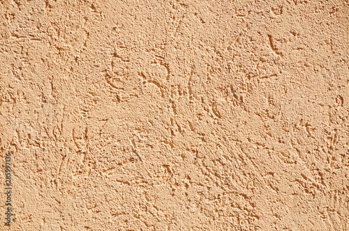 Sandy-colored modern grainy stucco texture #285997136