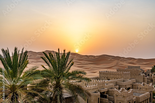 Poster Deep brown Qasr Al Sarab in Liwa, Al Dhafra, Abu Dhabi, United Arab Emirates at sunset