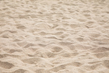 Closeup Brown Sand On The Beach