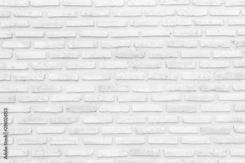 Tuinposter Baksteen muur Wall white brick wall texture background in room at subway. Interior rock old clean uneven tile design, horizontal architecture wall.